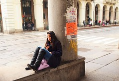 Turin - Girl with pink bag and black boots (JohnVenice) Tags: girl street phone pinkbag younggirl italian turin torino italy