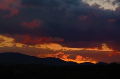 Light through darkness (Sunset Master) Tags: light darkness sunset nature sky landscape eli adams mountains vermont cloudy red orange rays blue