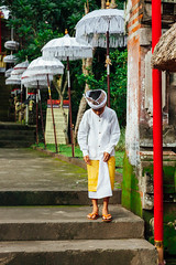 Boy in traditional balinese clothes (Evgeny Ermakov) Tags: asia asian bali balinese dayofsilence indonesia indonesian newyear nyepi silence silenceday southeast southeastasia ubud ancient boy candid celebration ceremony child city clothes colorful colors cultural culture cultures decoration decorations destination exotic famous fashion holiday holidays kid life local religion religious ritual scene scenery scenic spirituality stairs street style temple touristic traditional travel typical umbrella vacation vibrant white yellow young editorialuse