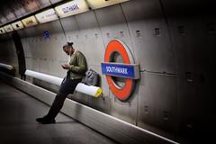 Shuffle (Douguerreotype) Tags: candid london people sign uk underground urban british city tunnel britain subway tube gb metro england