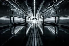 Onwards (Vemsteroo) Tags: barcelona spain blackandwhite bw monochrome silver hue urban lines architecture escalators tunnel forward fujifilm fuji xt2 23mm 14 diagonals light cityscape exploring futuristic night dark building symmetry abstract
