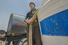 Hardship in the Desert_200 (EU Humanitarian Aid and Civil Protection) Tags: iraq fallujah anbar water nrc norwegianrefugeecouncil children desert tank boy tanker truck