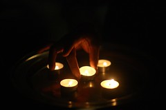 Diwali is coming right ? (N A Y E E M) Tags: candle light hand fire mahi bartender night baikalbar closeup hotel radissonblu chittagong bangladesh sooc availablelight indoors