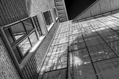 Shadowplay (McQuaide Photography) Tags: city light shadow blackandwhite bw holland reflection building window haarlem netherlands glass monochrome lines architecture canon eos mono licht blackwhite europe bricks nederland handheld fullframe dslr schaduw 1740mm stad gebouw lightroom 6d lseries blacksky canon6d rechtspraak mcquaidephotography rechtbankhaarlem