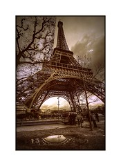 La Tour Eiffel (Missy Jussy) Tags: street trees light sky people paris france architecture clouds canon reflections puddle europe tour streetlamp eiffeltower streetphotography structures police eiffel historical tamron historicalcity tamron1024mm treeshaping cannon600d