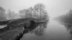 Tranquility (Pete Rowbottom, Wigan, UK) Tags: uk greatbritain morning bridge trees winter england blackandwhite mist reflection ice water monochrome weather fog wow landscape mono canal vanishingpoint interesting foggy tranquility lancashire getty british serene istock sillhouette atmospheric towpath marylebone wigan waterscape waterreflections stonebridge leedsliverpoolcanal haigh haighhall stockimage monochromia visitengland uklandscape ukwinter mistywater photographymono nikond7100 lancashireinteresting wiganphotographer wiganphotographers peterowbottom landscapemono
