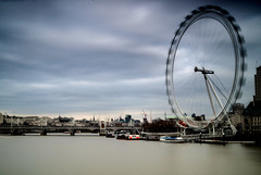 A Gloomy Eye (dolbinator1000) Tags: uk bridge england sky building london eye water wheel thames clouds river grey boat big movement long exposure cityscape gloomy crane parliament