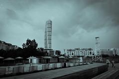 Malm III (Foto di Aringhe) Tags: ocean city bridge blue sea white black beach architecture skyscraper buildings dark nikon cloudy sweden torso tall sverige bro malm hue turning malmo bron d300 broen 18200mm