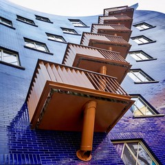 Balladeering (Paul Brouns) Tags: uk greatbritain blue windows england sky urban brown abstract london architecture facade square steps perspective lookingup lookup architektur balconies sequence rhythm architectuur upward londen intothesky