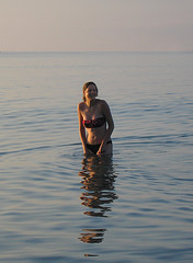 "Dawn Swim - ""It's lovely and warm"" (not) (jonathan charles photo) Tags: morning light sea sun art beauty smile swim dawn photo topf50 jonathan charles bikini"