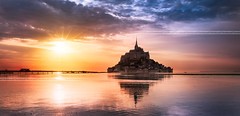 Mont Saint Michel at sunset, France (beatricepreve) Tags: world travel blue light sunset sea sky france castle heritage church water abbey saint st architecture night french island evening town twilight frankreich brittany europe tide famous gothic violet bretagne landmark unesco le michel normandy mont hdr montsaintmichel saintmichel bassenormandie