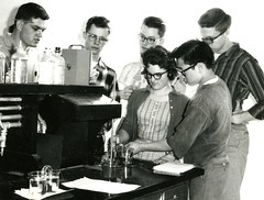 A group works on electrochemistry (PUC Special Collections) Tags: electrochemistry batteries laboratory lab pacificunioncollege chemistrydepartment chemistrylab chemistry beakers test tubes scientist labcoat experiments angwin california adventist sda seventhdayadventist college