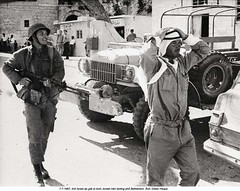 BE026167 (ngao5) Tags: road street two people history walking soldier israel hands war asia gun head westbank military rifle middleeast jordan weapon marching vehicle bethlehem twopeople interaction militaryvehicle capturing militarypersonnel historicevent asianhistoricalevent motorvehicle palestinianterritories southwestasia sixdaywar israelihistoricalevent bethlehemgovernorate arabisraeliwars