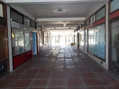 Under the Molem (doojohn701) Tags: tiles shops stark white bulkhead sunlight windows food cafe vintage retro 1960s functional