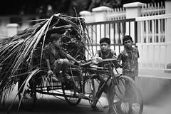 Drag your future (N A Y E E M) Tags: boys rickshawvan child labourers candid portrait street navalavenue chittagong bangladesh windshield