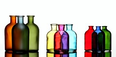 3 by 3 (Karen_Chappell) Tags: bottles three 3 white stilllife product glass bottle group colourful colours colour multicoloured yellow red blue green orange purple sets pink