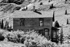Ghosts Through the Window (Scosanf) Tags: mountains rockymountains sanjuanmountains colorado coloradotrails outdoor abandoned forgotten historic miningtown blackandwhite bw monochrome travel trip vacation summer canon eos 6d ef2470mmf28lusm topazlabs ghosttown