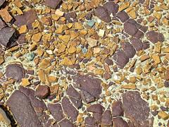 mosaic (skylinejunkie) Tags: bigknifeprovincialpark alberta canada nature desert rocks stones pebbles arid dry hoodoos erosion orange burgundy purple mosaic summer sand earth ground