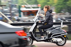 Scooter Girl in A Hurry (FaceMePLS) Tags: amsterdam nederland thenetherlands facemepls nikond5500 straatfotografie streetphotography tweewieler meisje nikesneakers snorscooter vespa windscherm windshield