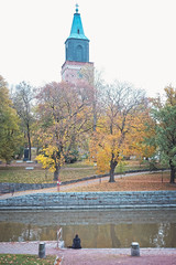 Solitary (Jani M) Tags: street urban person sitting church river autumn fall lonely alone solitary
