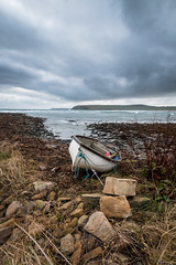 Tethered (MBDGE) Tags: orkney sea scotland sky seascape boat beach blue britain water wave stone stones storm shoreline canon 70d gale northsea