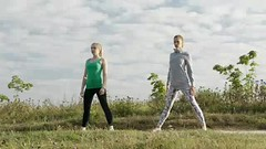Two girls training. (greycoastmedia) Tags: summer two people woman motion nature girl field grass sport train training person countryside video athletic healthy day exercise outdoor stretch health together gymnast gymnastics fitness sporting stretching aerobics active physical footage sportive stockvideo greycoastmedia