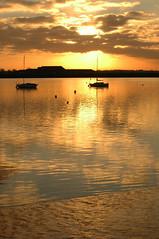 Reflected Light (amanda.parker377) Tags: sunset boats cloudformation reflectivelight