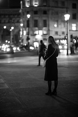 Waiting Lady (Ajc-Photo-Film) Tags: lighting street city light blackandwhite colour london lights low streetphotography 85mm sigma busy rush samyang