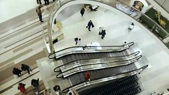 People traffic in big light trade center (greycoastmedia) Tags: light people motion building architecture modern mall video big ride traffic walk interior escalator indoor customer shoppingcenter tradecenter consumer footage movingstaircase highangle movingstairway stockvideo greycoastmedia