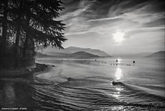 Colmegna (roby22-1-1950) Tags: alberi lago nuvole sole acqua riflessi onde