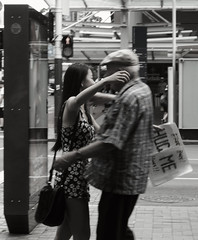 Two Generations Embrace (Wumi.A) Tags: street new old people bw woman man cute love photography hug candid young strangers free auckland zealand generations humans