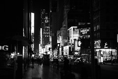 Handys and 52nd. (Steven.O'Toole) Tags: street new york city light boy shadow people bw woman white man black men girl night canon silver photography grey women day cityscape candid gray 70d 18135mm