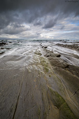 Stormy Barrika V. (dasanes77) Tags: ocean longexposure sea seascape storm green beach rain vertical clouds sunrise landscape dawn rocks horizon tripod dramaticsky cloudscape waterscape barrika flysch cloudsmovement canoneos6d samyang14mm28 stormybarrika