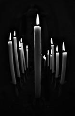 McCandels (N i n f a s d e l v i e n t o ) Tags: candelas velas candels black white soft lighting church iglesia fire fuego luz oscuridad dark darkness candelabros pasion night darklight sombrio