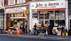 London shops, Chepstow Place, Bayswater, London 1977 or -78 (Gsta Knochenhauer) Tags: 1977 pappas15009 england shop street analog pentax john p dennis by grace god his 8 children johnpdennisandbythegraceofgodhis8children second hand store london chepstow place pappa