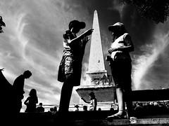 Talking point (EEtchart) Tags: menorca spain ciutadella blackandwhite pyramide streetphotography holidays market children sky cloud