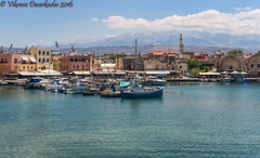 View of the old Venetian Harbor of Chania from the seawall - Chania, Crete, Greece (vdwarkadas) Tags: harbor chania chaniaharbour water crete greece mountains sony sonynex5t cityscape