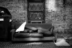 (301/366) Another Couch in Another Alley (CarusoPhoto) Tags: couch alley chicago garbage dump john caruso carusophoto photo day project 365 366 bw black white brick wall street pentax ks2 hd pentaxda l 1850mm f456 dc wr re hdpentaxdal1850mmf456dcwrre found