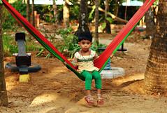 Startled (kissoflif3) Tags: kid hammock girlonahammock gokarna india girl shocked dumbfound colorful colors candid streetphotography