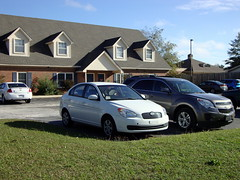Our Vehicles. (dccradio) Tags: lumberton nc northcarolina robesoncounty aftermath stormaftermath hurricane matthew hurricanematthew recovery hyundai accent chevy chevrolet equinox building architecture apartments sky bluesky grass lawngreenery