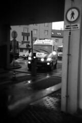 Holga 120FN - Incoming Ambulance (Kojotisko) Tags: street city people bw streets person holga czech streetphotography brno cc creativecommons czechrepublic streetphoto persons fomapan holga120fn