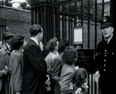 Metropolitan Police 'A' Division Police Sergeant Attached To Cannon Row Police Station (Alpha Delta) On Duty In Stable Yard Road, St. James's Palace, Westminster, London, SW1. UK. circa 1950's. (sgterniebilko) Tags: uk london westminster ad security 1950s royalty themall sw1 royals royalfamily centrallondon scotlandyard stjamess metropolitanpolice clarencehouse alphadelta policeconstable inuniform canonrow stableyardroad cannonrowpolicestation aorwhitehalldivision