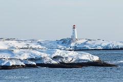 Peggy's Point Lighthouse (laszlofromhalifax) Tags: ocean winter snow canada cold water novascotia snowy shoreline rocky coastal granite getty peggyscove atlanticocean atlanticcanada