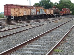 Resting Goods Carriages (mikecogh) Tags: metal graffiti rust tracks rollingstock korumburra goodscarriages