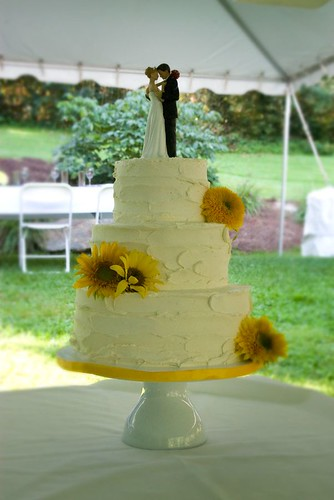 """A country chic wedding cake that is yellow with sunflowers. • <a style=""""font-size:0.8em;"""" href=""""http://www.flickr.com/photos/50891271@N03/16347978945/"""" target=""""_blank"""">View on Flickr</a>"""
