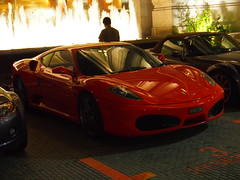 A red supercar outside of Raffles Hotel, Singapore!