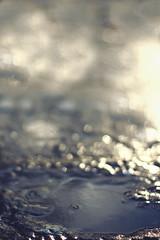Light and Water (Gure Elia) Tags: blue light macro water azul puddle agua bokeh 14 reflejo pamplona taconera charco irua canon50mm14 destellos canon550d canoneos550d