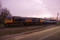GBRf 66717 hauling DVT 82127 at Ely station
