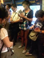 Damn Good Advise . (Faisal Aljunied) Tags: people train asian photography reading book yahoo singapore asia southeastasia flickr candid transport streetphotography transportation damn iphone advise streetphotographer aljunied flickriver georgelois iphoneography snapseed faisalaljunied damngoodadvise