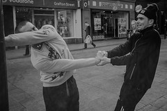 Stretching Out (romoophotos) Tags: street morning ireland dublin white black eye focus funny dancers stretch artists shops performers tracksuit shoppers grafton iop